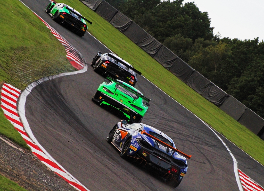Balfe Motorsport's McLaren 570S GT4 trails a group of GT3 cars through the Brittens chicane.