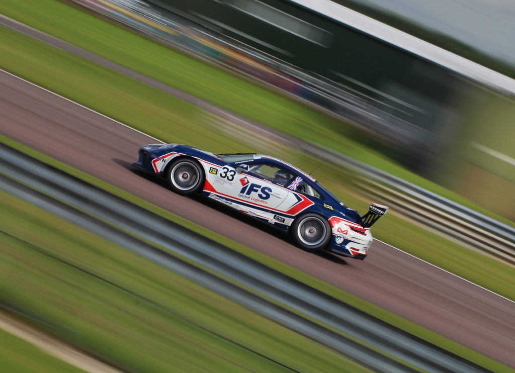 Daniel Harper, of the Porsche Carrera Cup GB, flies through the exit of Allard.