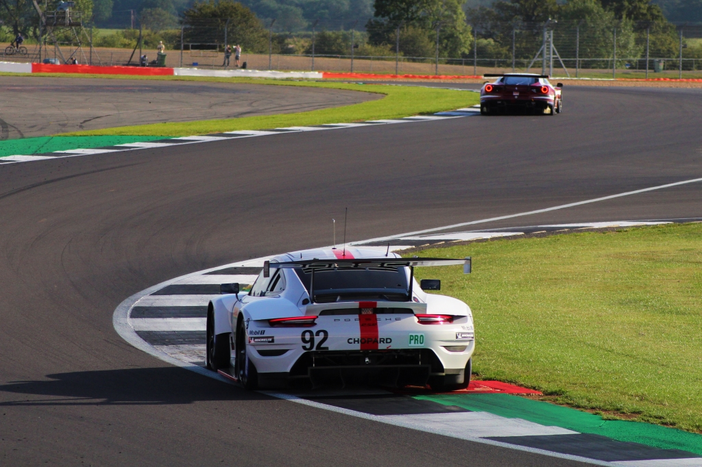 The Porsche GT Team's 911 RSR follows a Ferrari through the Maggotts/Becketts complex.