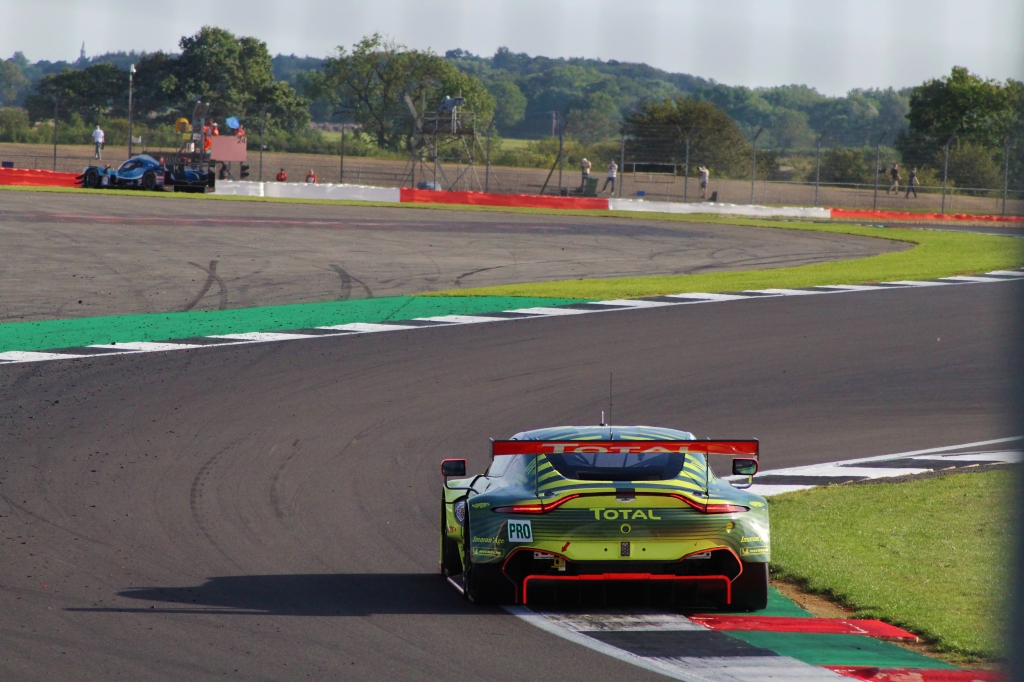 Aston Martin Racing's Vantage GTE takes to the curb at the entry of Maggotts corner.