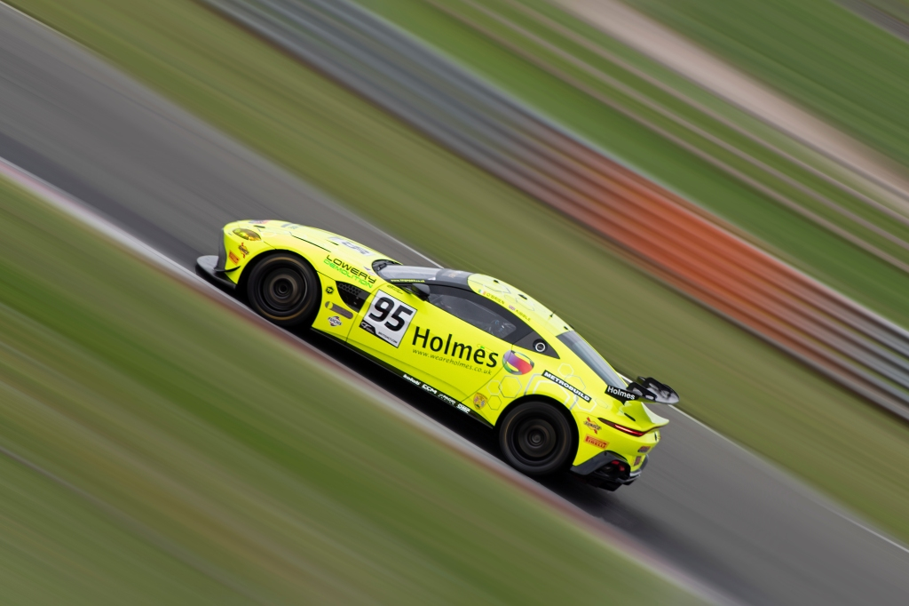 The faster of the two TF Sport Aston Martin Vantage AMR GT4s heads towards Coppice corner.