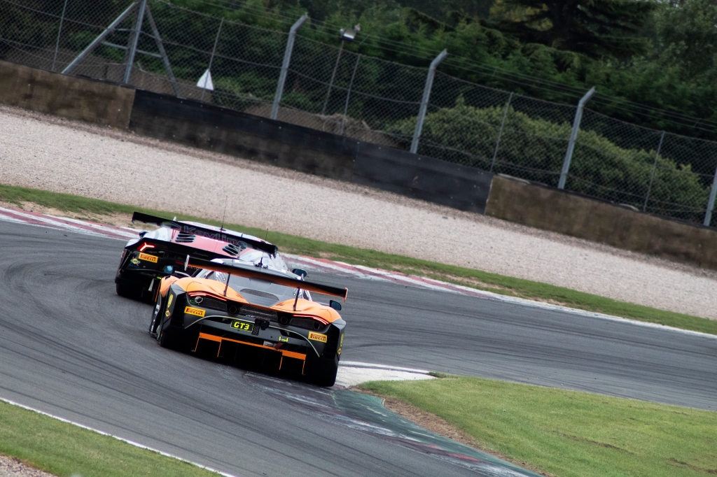 Optimum Motorsport's McLaren 720S GT3 tails a Lamborghini Huracan GT3 EVO through Coppice corner.