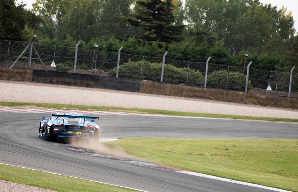 One of 2 Seas Motorsport's McLaren 720S GT3s kicks up dirt at Coppice corner.